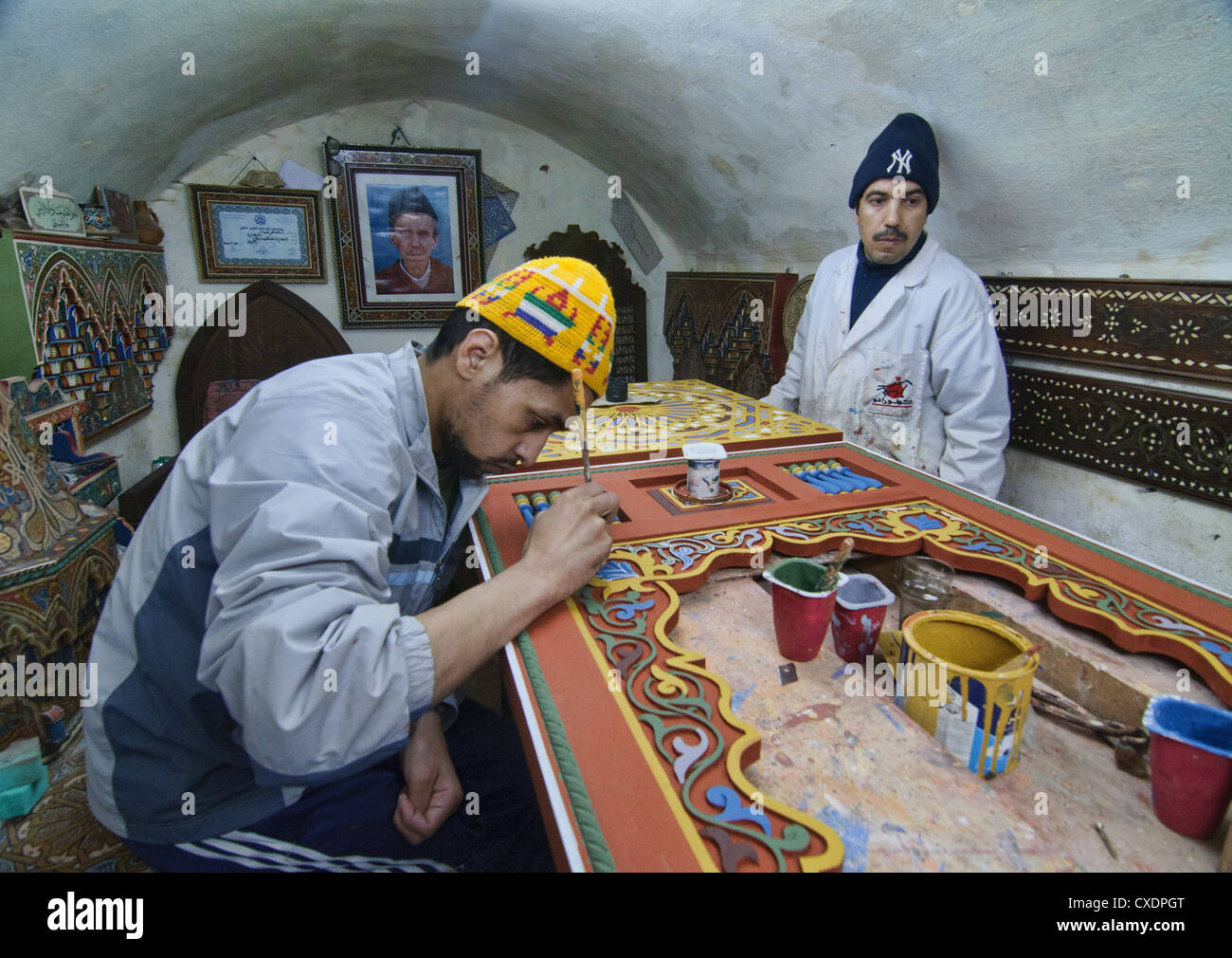 artisan painting in the ancient medina of Fes, Morocco - Stock Image