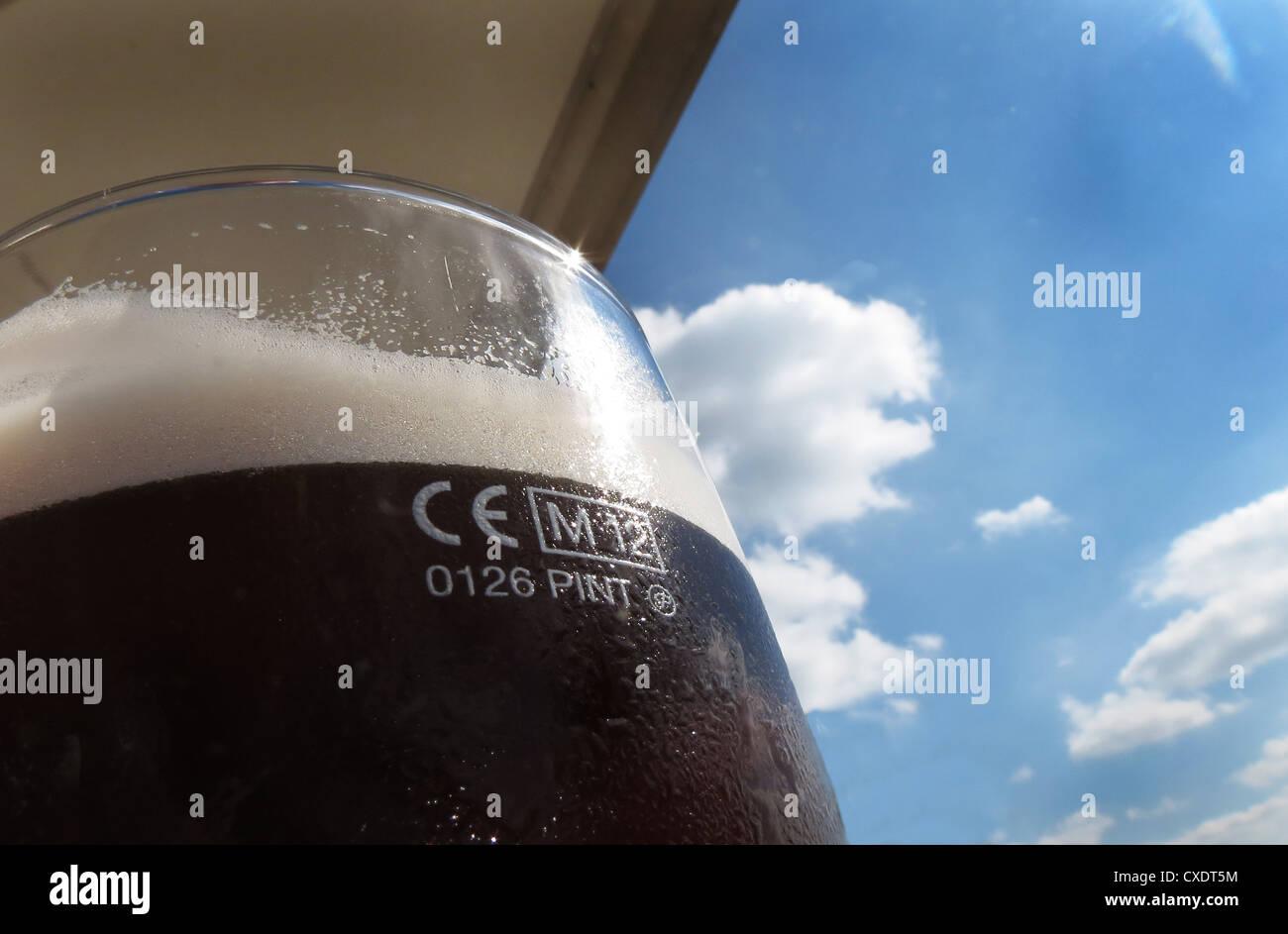 Detail of measure of UK beer pint glass. - Stock Image