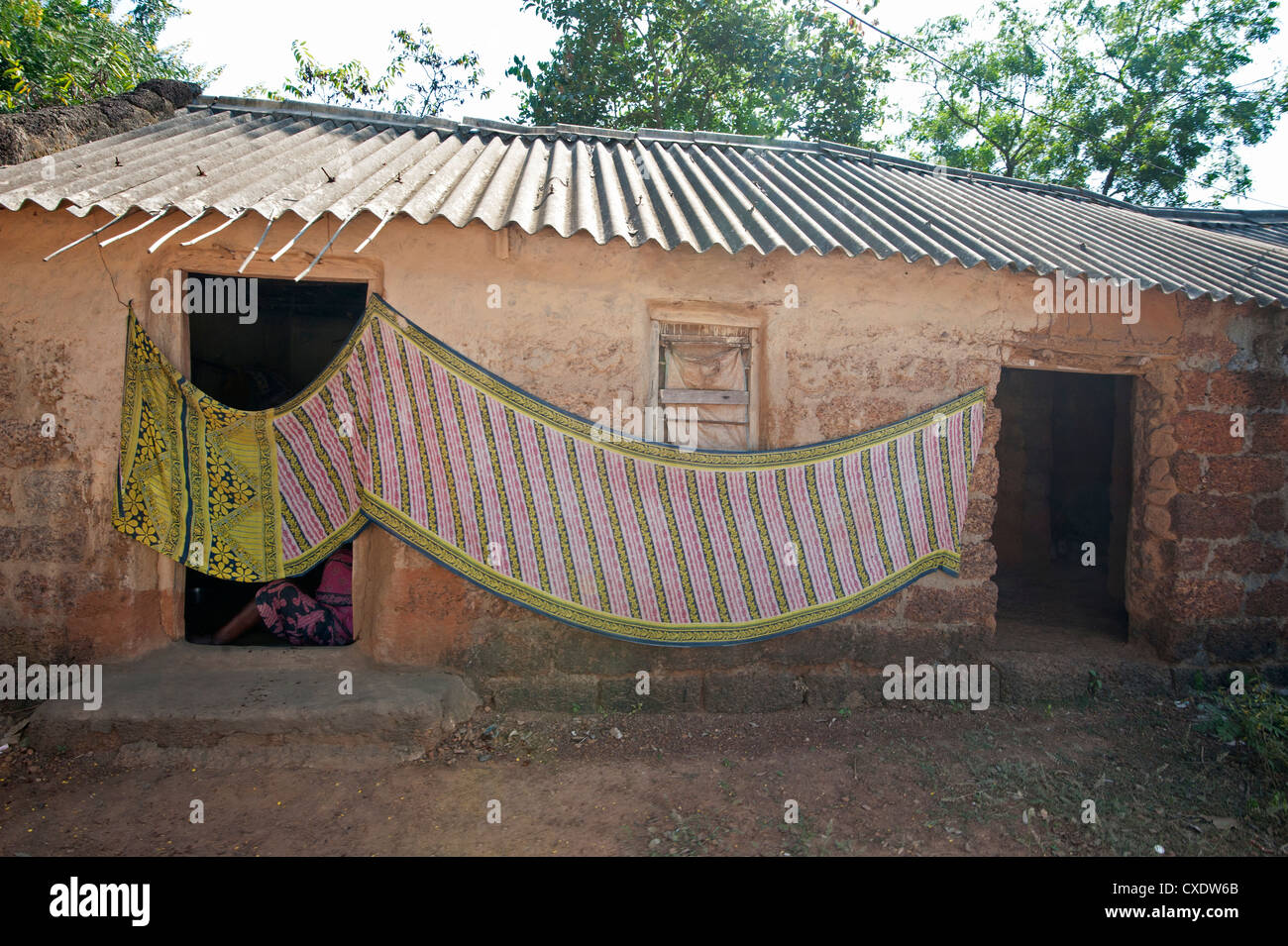 Cotton Sari Being Hung Out To Dry Across Village House Wall Rural Orissa India