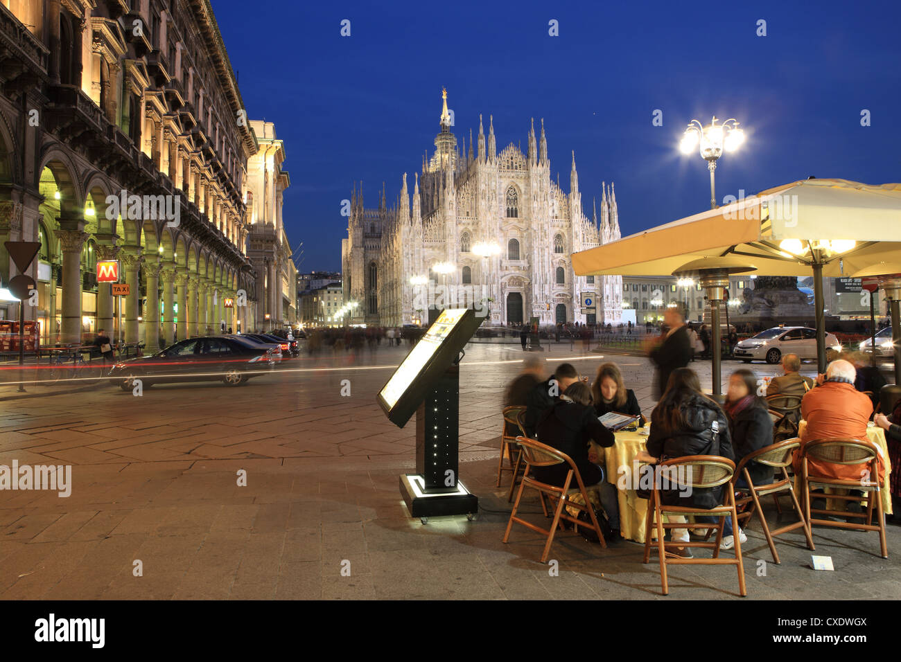 Restaurant in Piazza Duomo at dusk, Milan, Lombardy, Italy, Europe - Stock Image