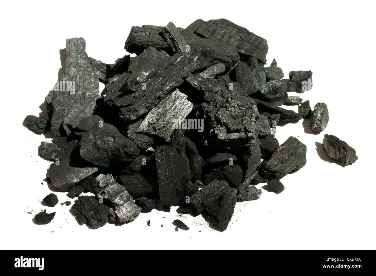 Natural charcoal close up. White isolated - Stock Image