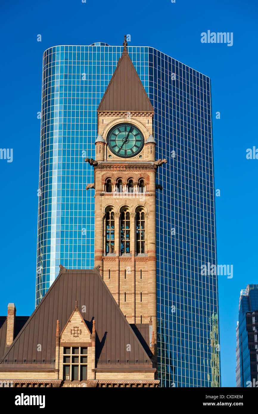 Clock tower of the Old City Hall contrasts with modern skyscraper, Toronto, Ontario, Canada, North America - Stock Image
