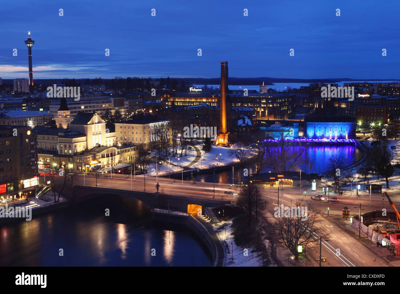 River Tammerkoski runs through the city centre, past the Finlayson Complex, night time in Tampere, Pirkanmaa, Finland - Stock Image