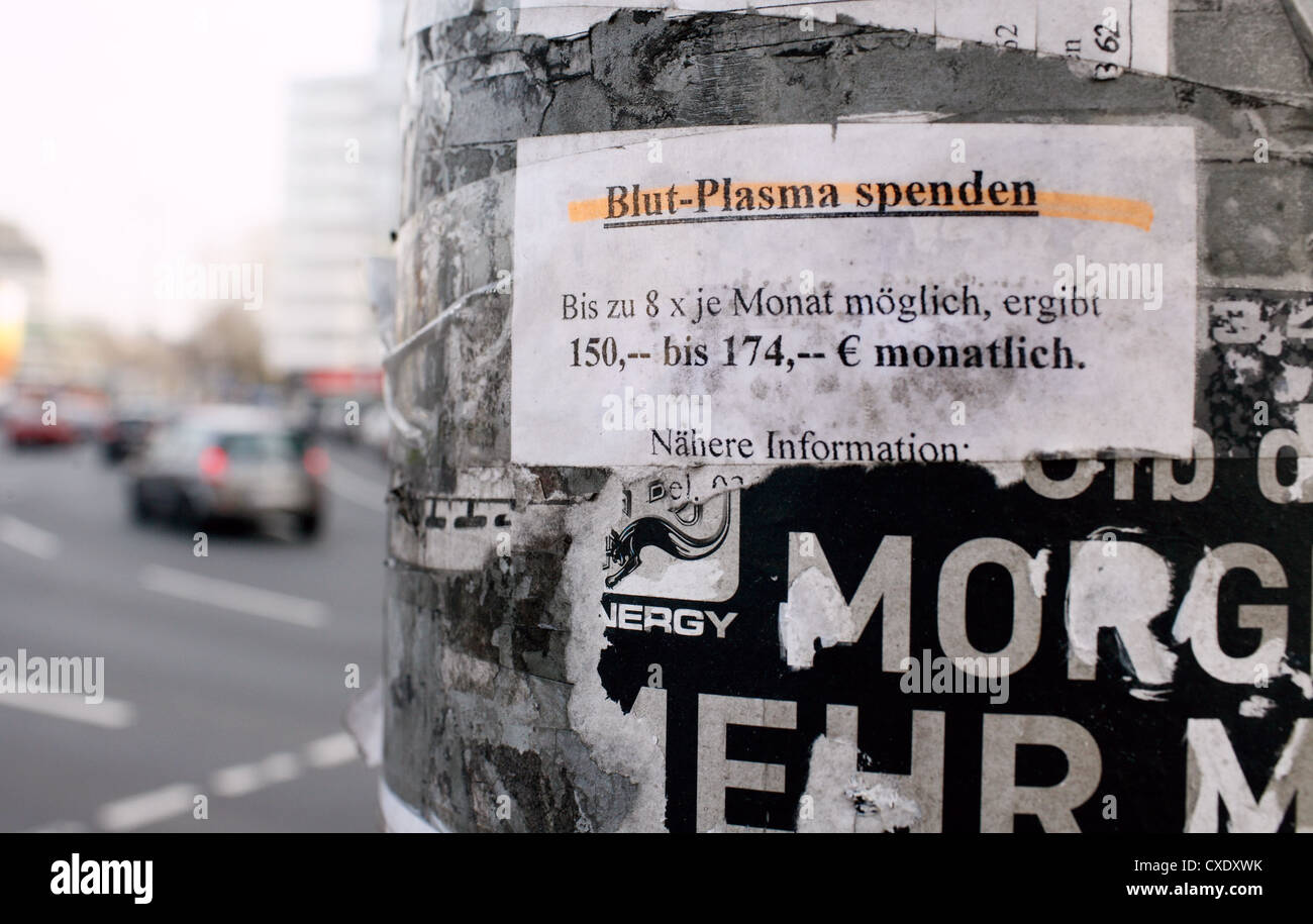 Berlin, note that says donate blood plasma at a traffic light - Stock Image