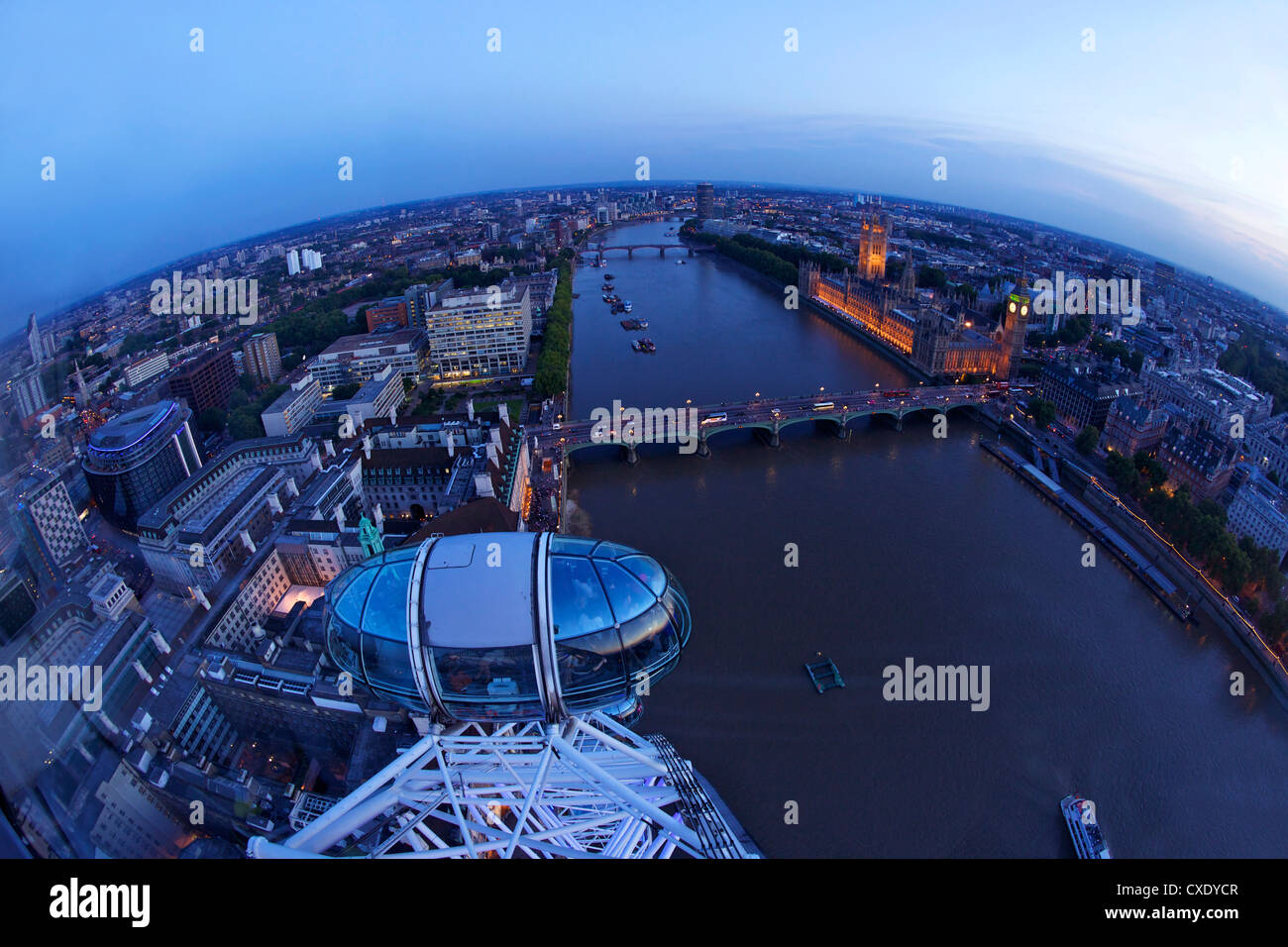 View of passenger pod capsule, Houses of Parliament, Big Ben and the River Thames from the London Eye at dusk, London, Stock Photo