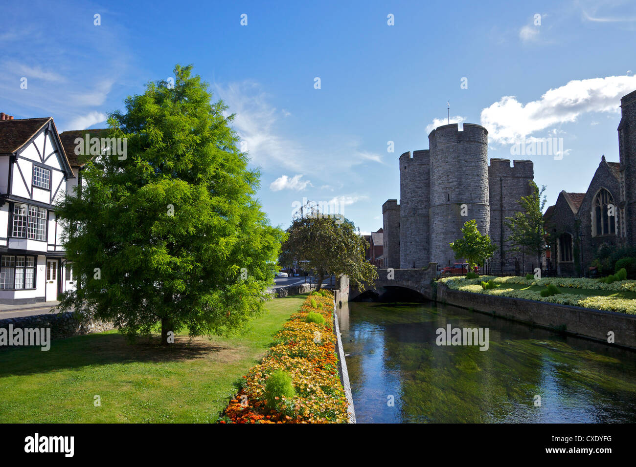 Westgate medieval gatehouse and gardens, with bridge over the River Stour, Canterbury, Kent, England, United Kingdom, - Stock Image