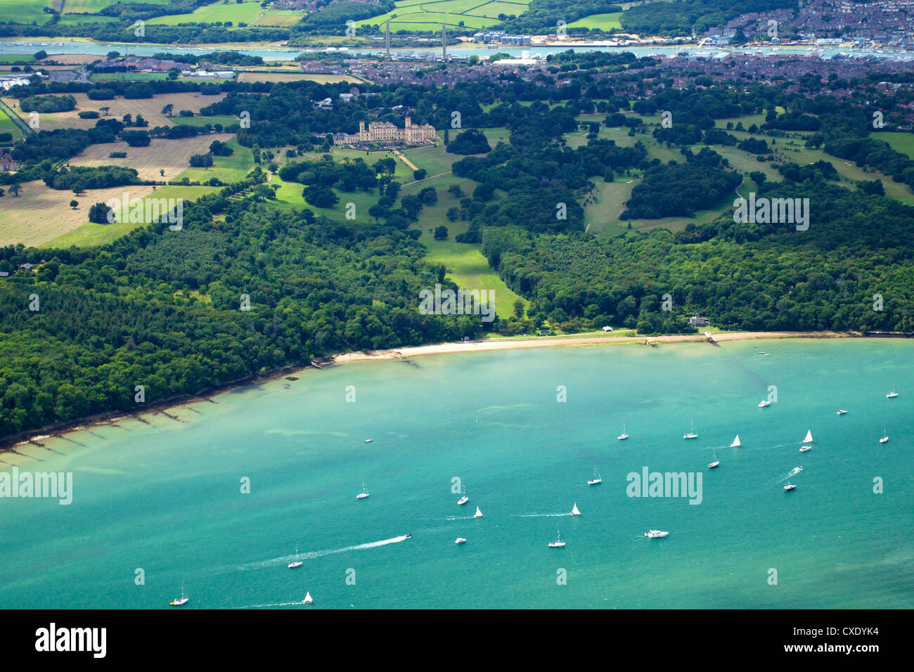 Aerial view of yachts racing in Cowes Week on the Solent, with Osborne House in background, Isle of Wight, England - Stock Image