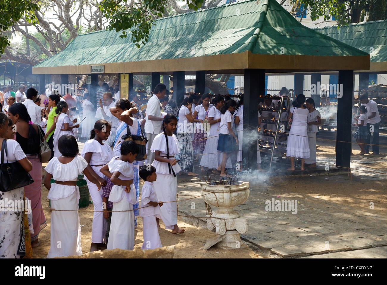 Buddhist pilgrims, Sri Maha Bodhi, sacred bodhi tree planted in 249 BC Unesco World Heritage Site, Anuradhapura, Stock Photo