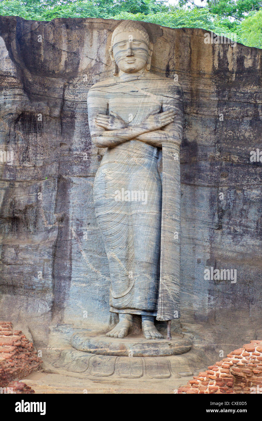 Buddha standing on lotus plinth in blessing posture, Gal Vihara Rock Temple, Polonnaruwa, Sri Lanka, Asia - Stock Image