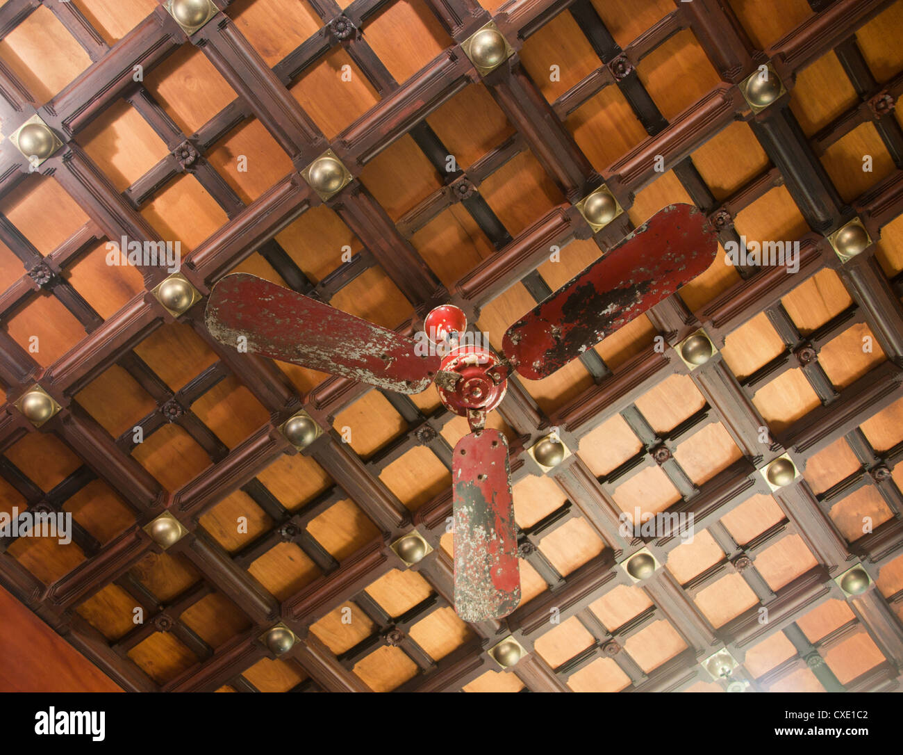 Old antique ceiling fan on wooden roof, India - Stock Image