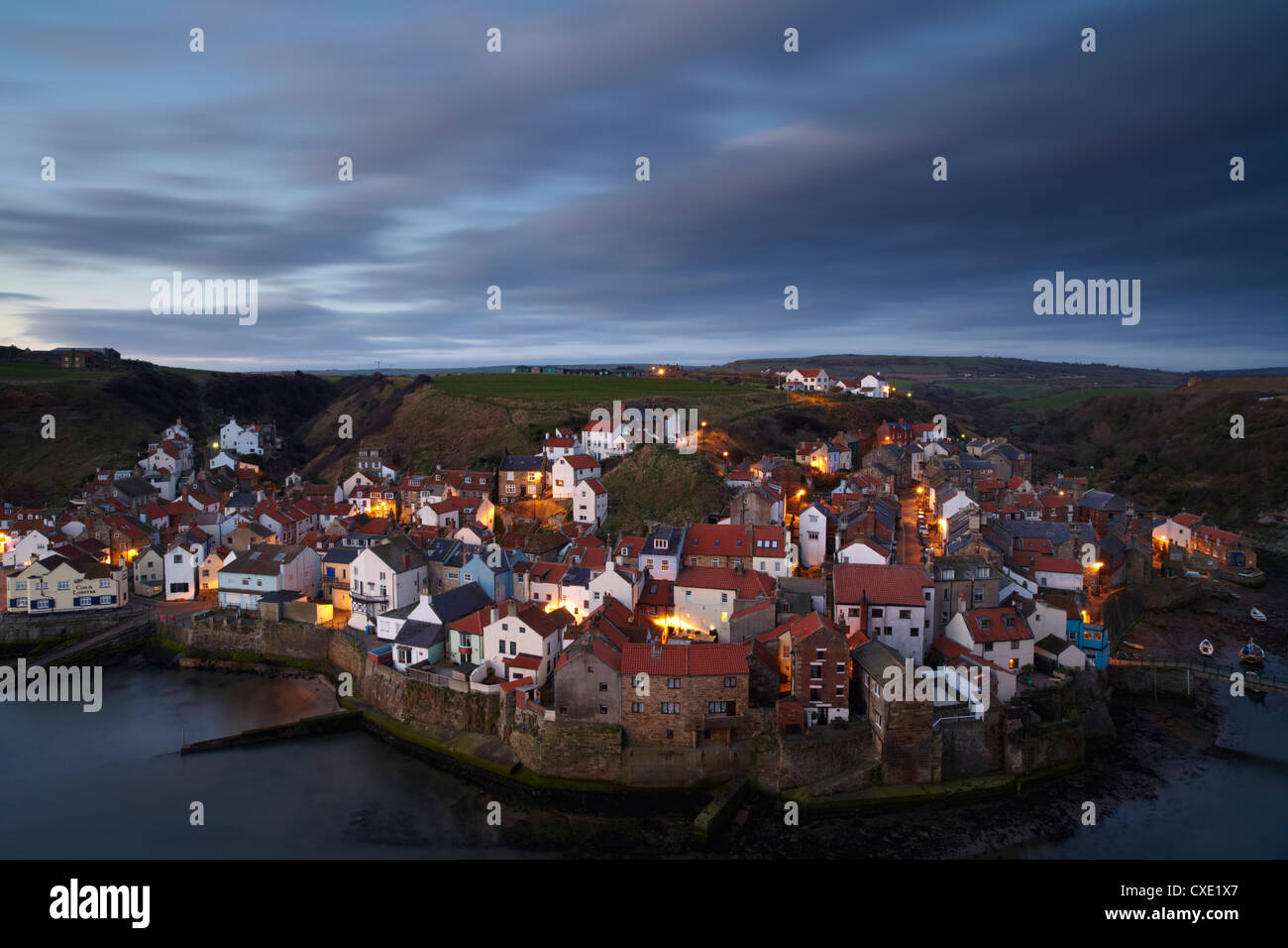 The view from Cowbar of the fishing village of Staithes, North Yorkshire, England - Stock Image