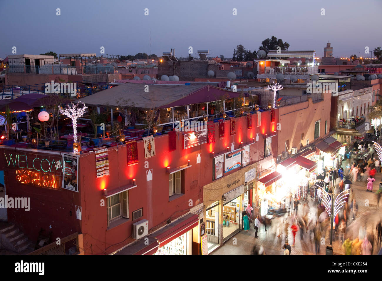 Busy street at dusk, Marrakesh, Morocco, North Africa, Africa - Stock Image