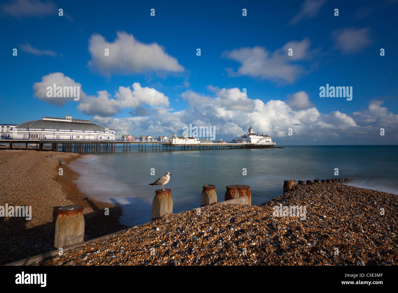 Pebble beach and pier, Eastbourne, East Sussex, England - Stock Image