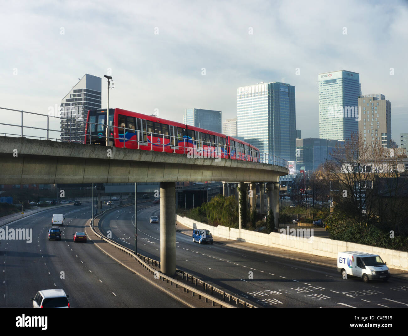 Overground train departing for canary wharf financial district, London, England, UK - Stock Image