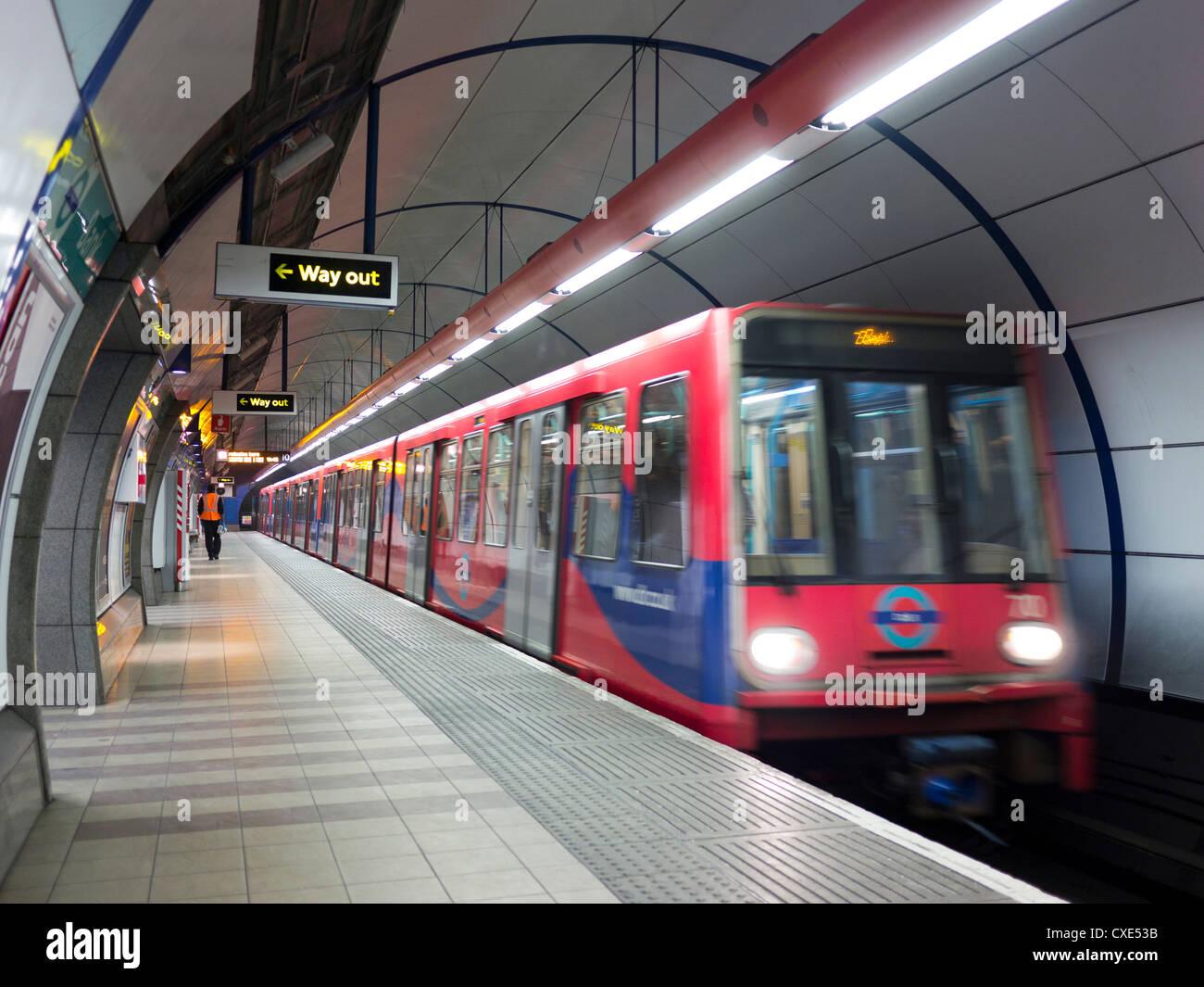 Underground Train departing station, London, England, UK - Stock Image