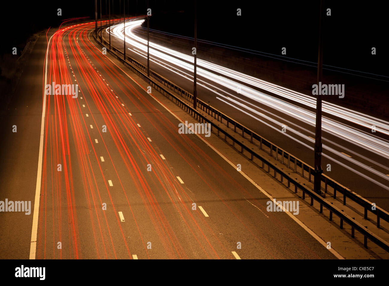 Light trails on M25 motorway at night, near London, England, UK, Europe. - Stock Image