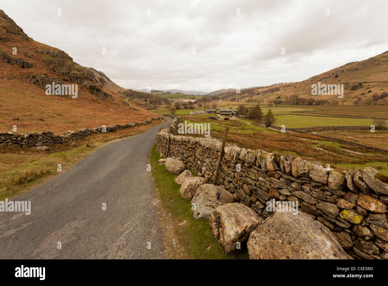Country road leading down from Wrynose Pass, Lake District National Park, Cumbria, England, United Kingdom, Europe - Stock Image