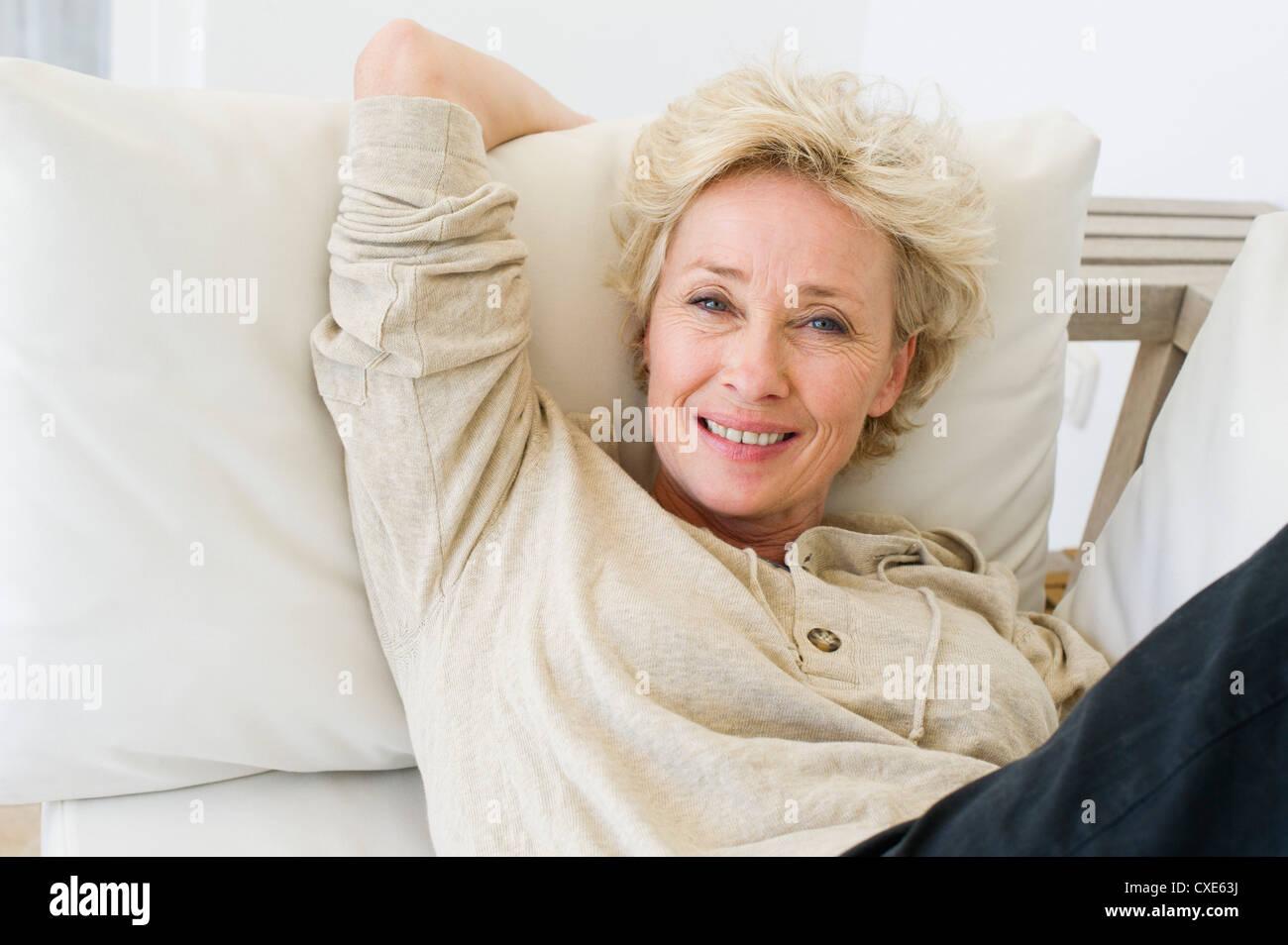 Mature plays on sofa