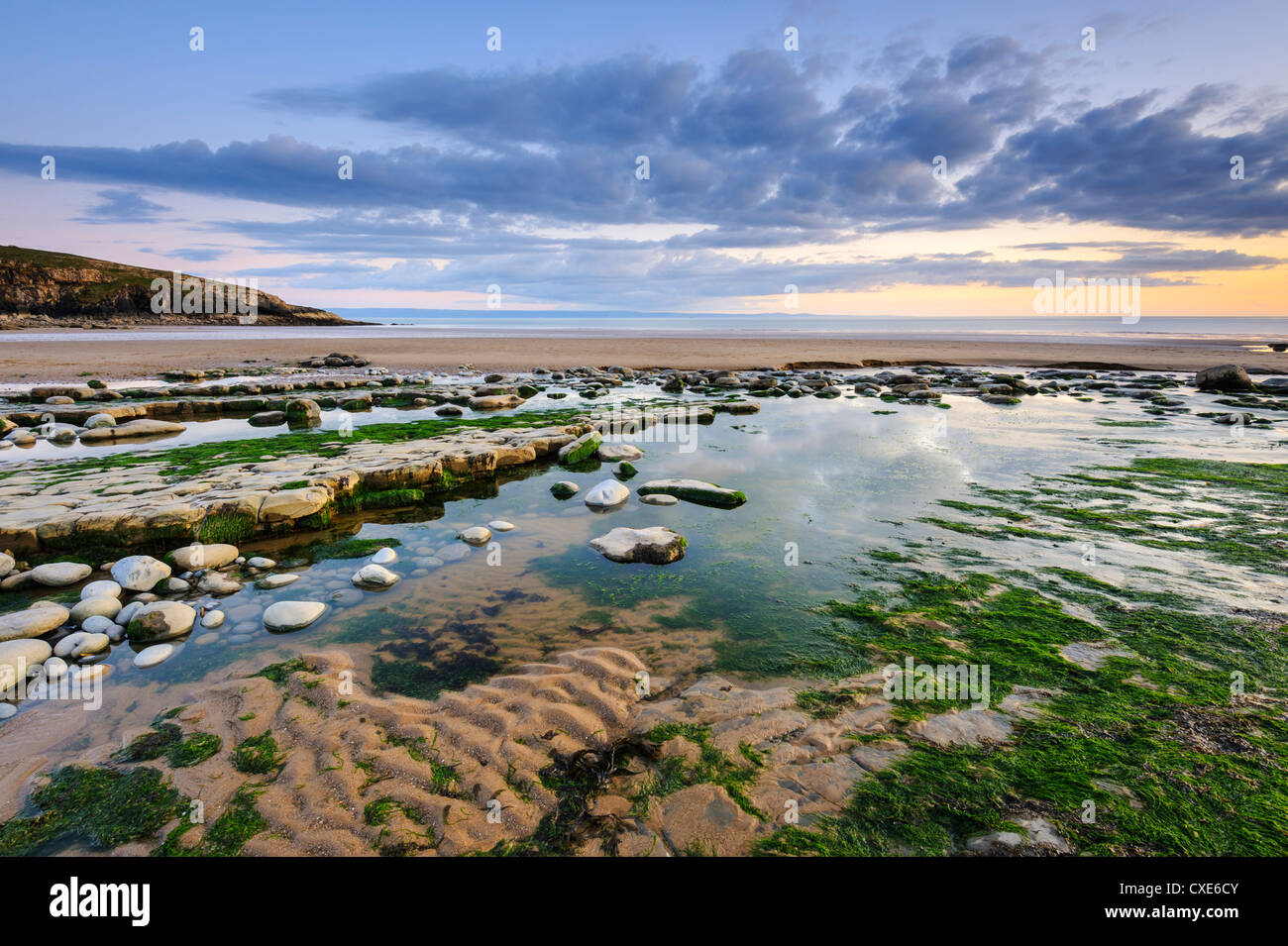 Sunset over rocks and pools at Dunraven Bay, Southerndown, Wales Stock Photo