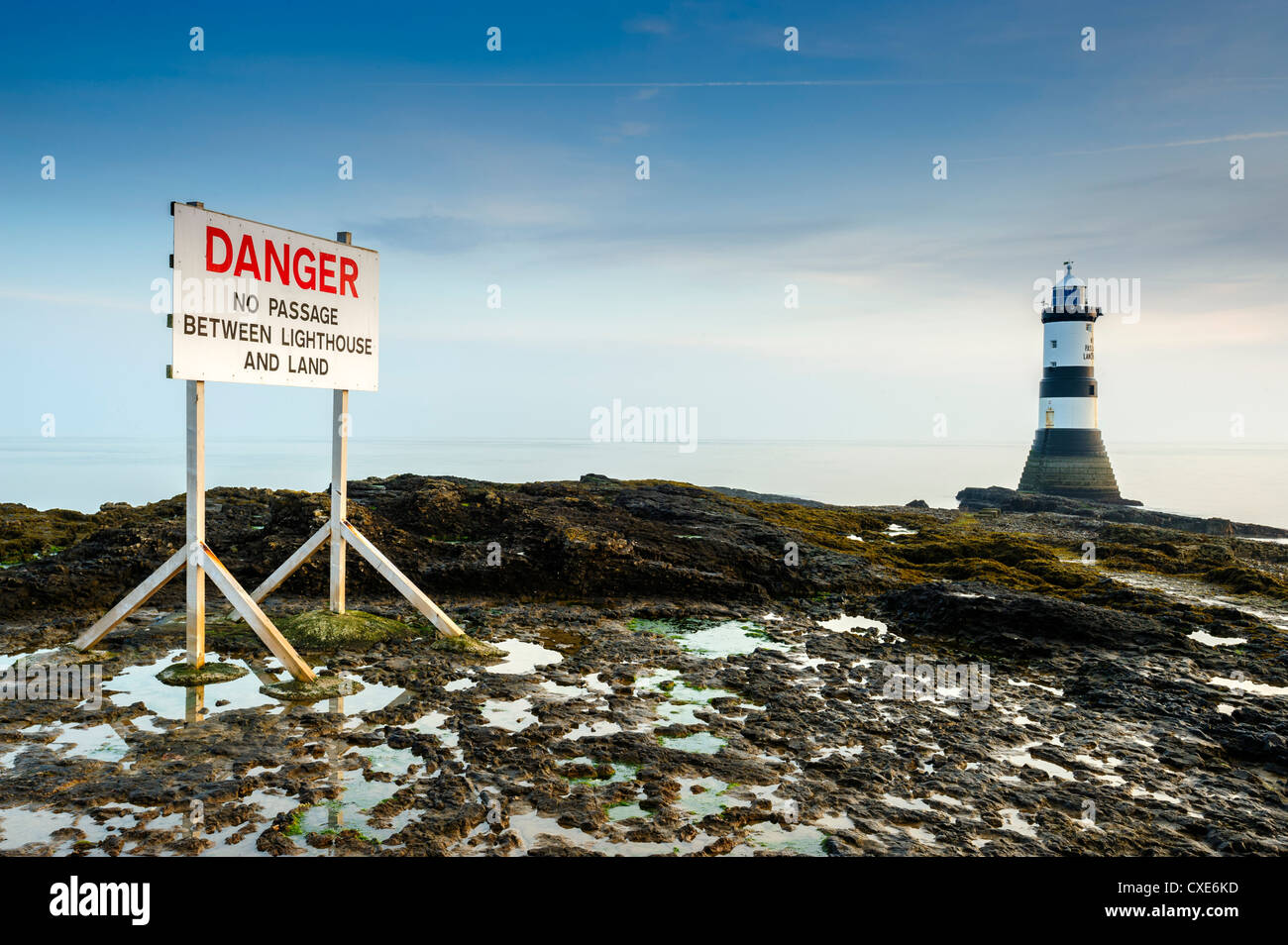 Warning sign at Penmon Lighthouse, Penmon Point, Anglesey, North Wales, Wales, United Kingdom, Europe - Stock Image