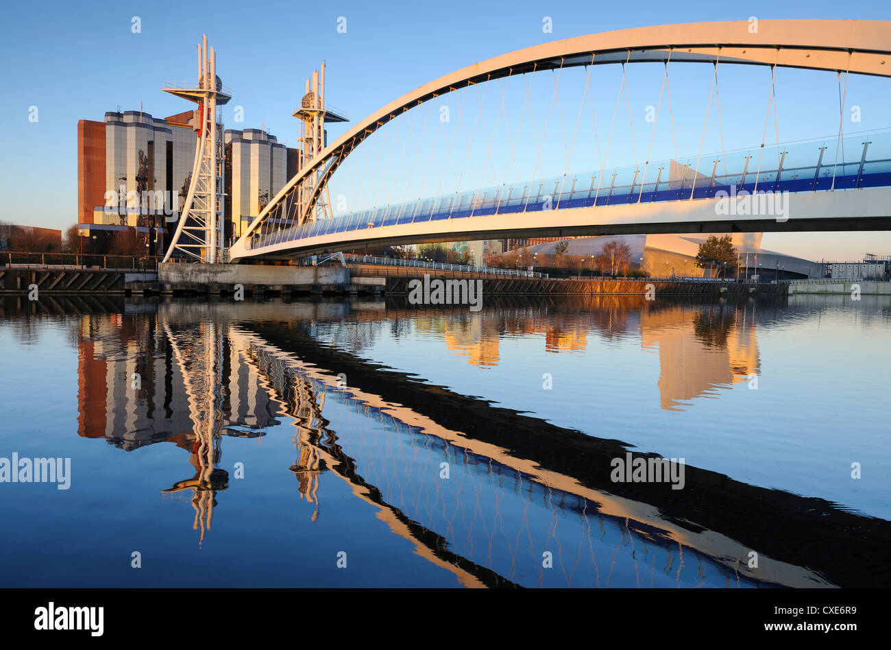 Early morning view of the Millennium Bridge, Salford Quays, Manchester, Greater Manchester, England, United Kingdom, - Stock Image