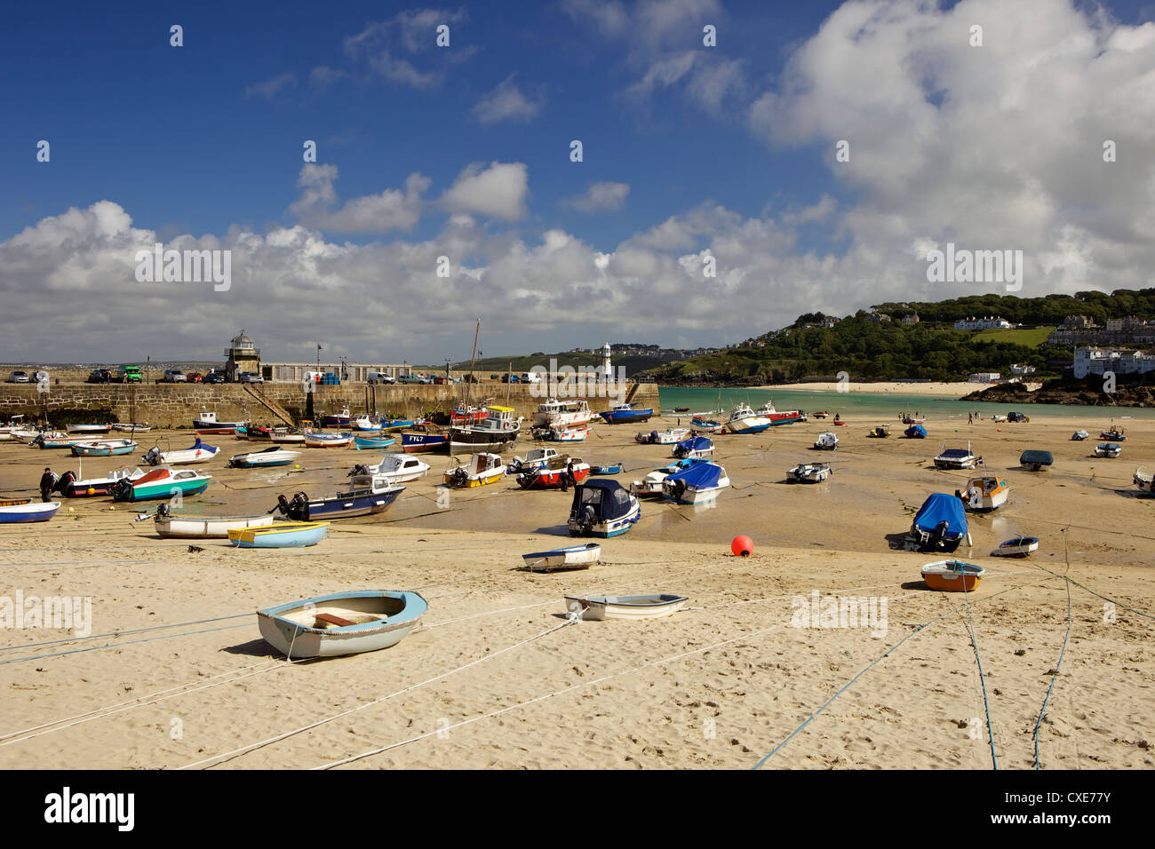 Boats in St Ives harbour at low tide, Cornwall, England Stock Photo