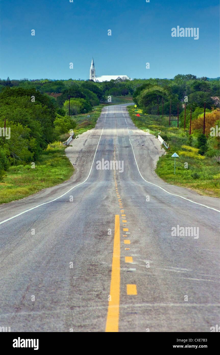 Highway TX-123, in far distance Virgin Mary Catholic Church in Cestohowa  (Czestochowa), Texas, USA