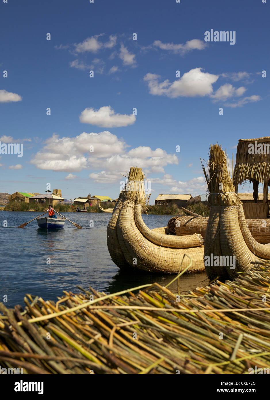 Aymara girl in a rowboat, Uros Island, Lake Titicaca, peru, South America - Stock Image