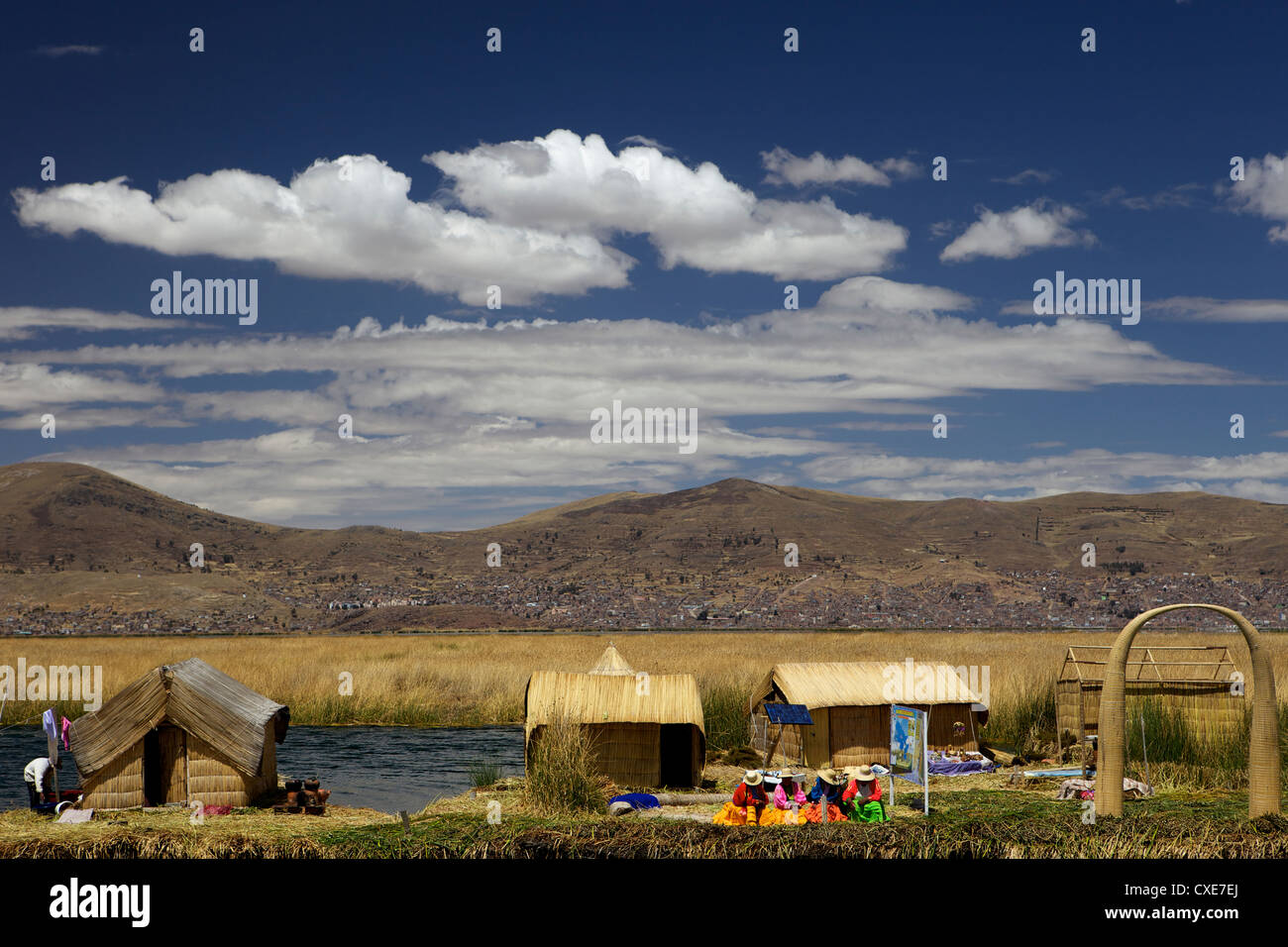 Floating islands of the Uros people, traditional reed boats and reed houses, Lake Titicaca, peru, peruvian, South Stock Photo