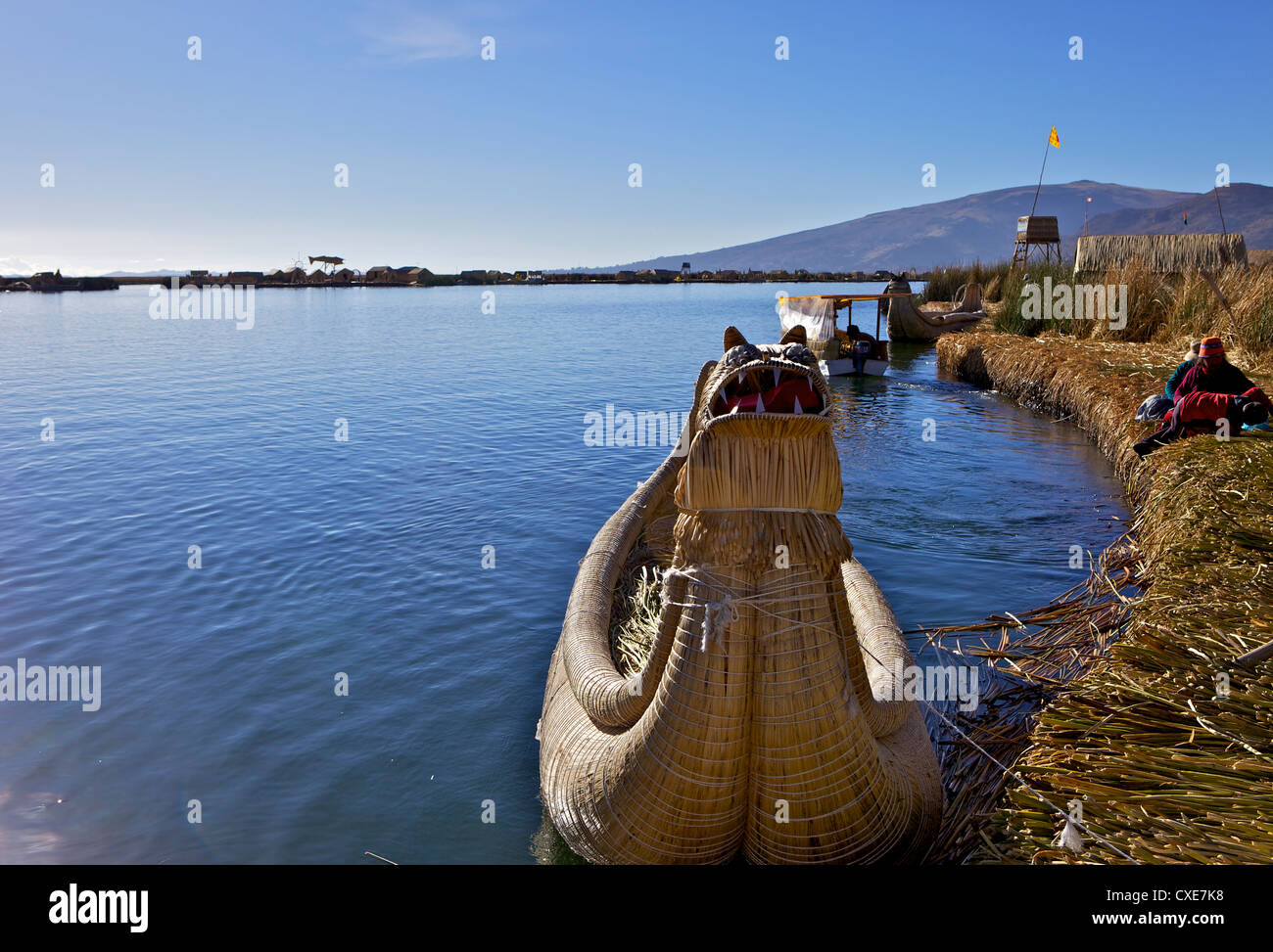 Floating islands of the Uros people, traditional reed boats and reed houses, Lake Titicaca, peru, peruvian, South - Stock Image