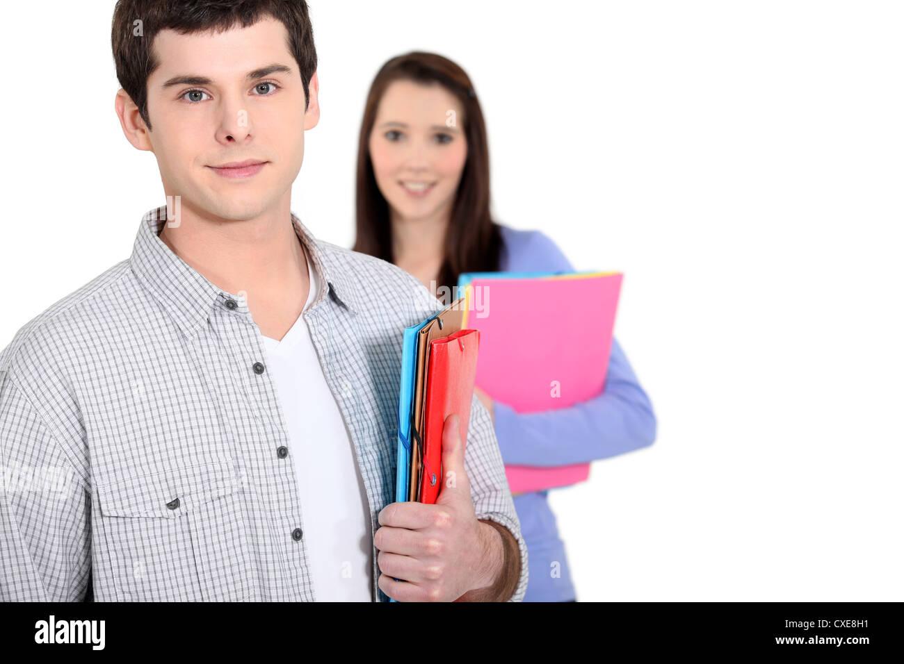 Teens with folders - Stock Image