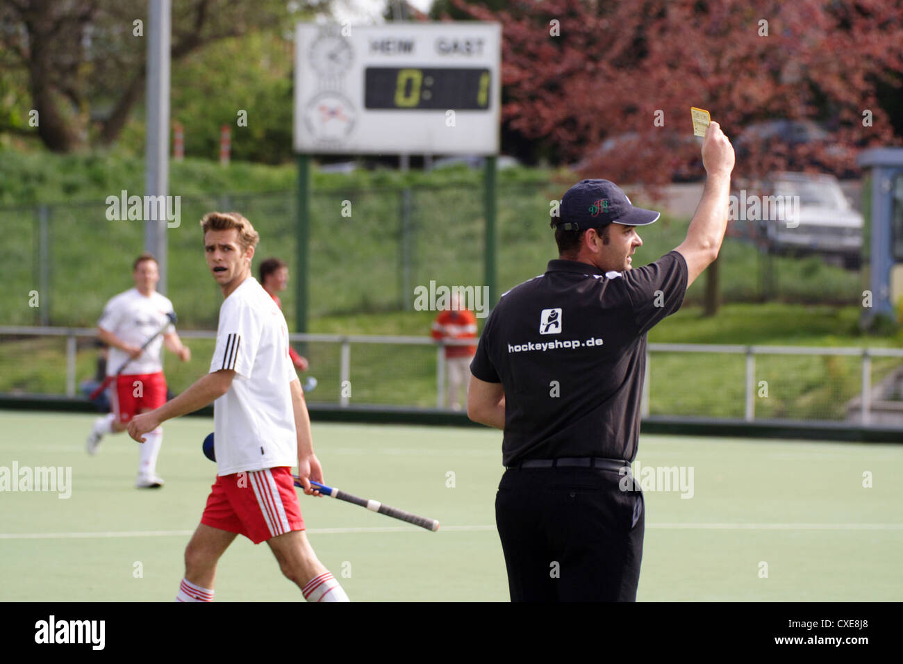 Ruesselsheim, referee gives a disgruntled hockey player the yellow card - Stock Image