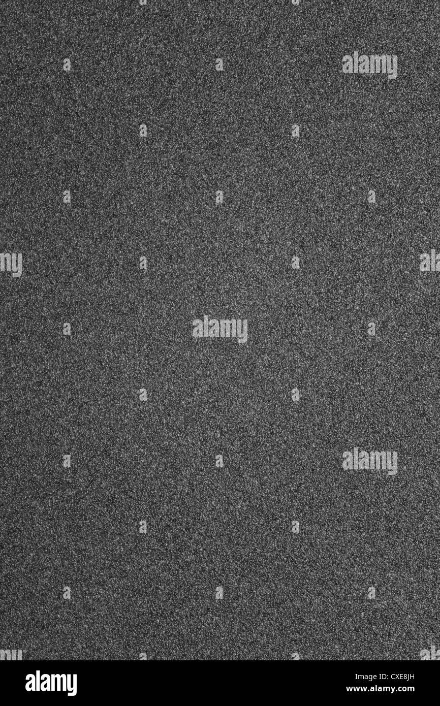 gray grain background, regular grainy monochromatic texture - Stock Image