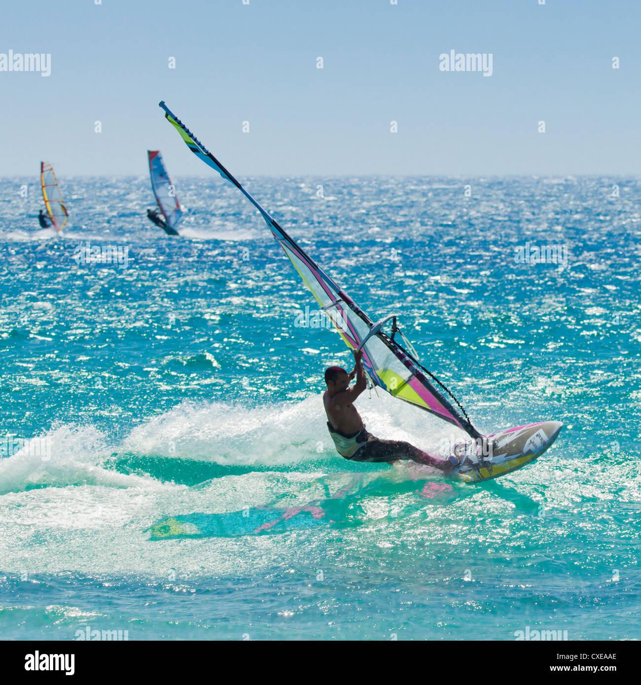 Windsurfer riding wave, Bonlonia, near Tarifa, Costa de la Luz, Andalucia, Spain, Europe Stock Photo