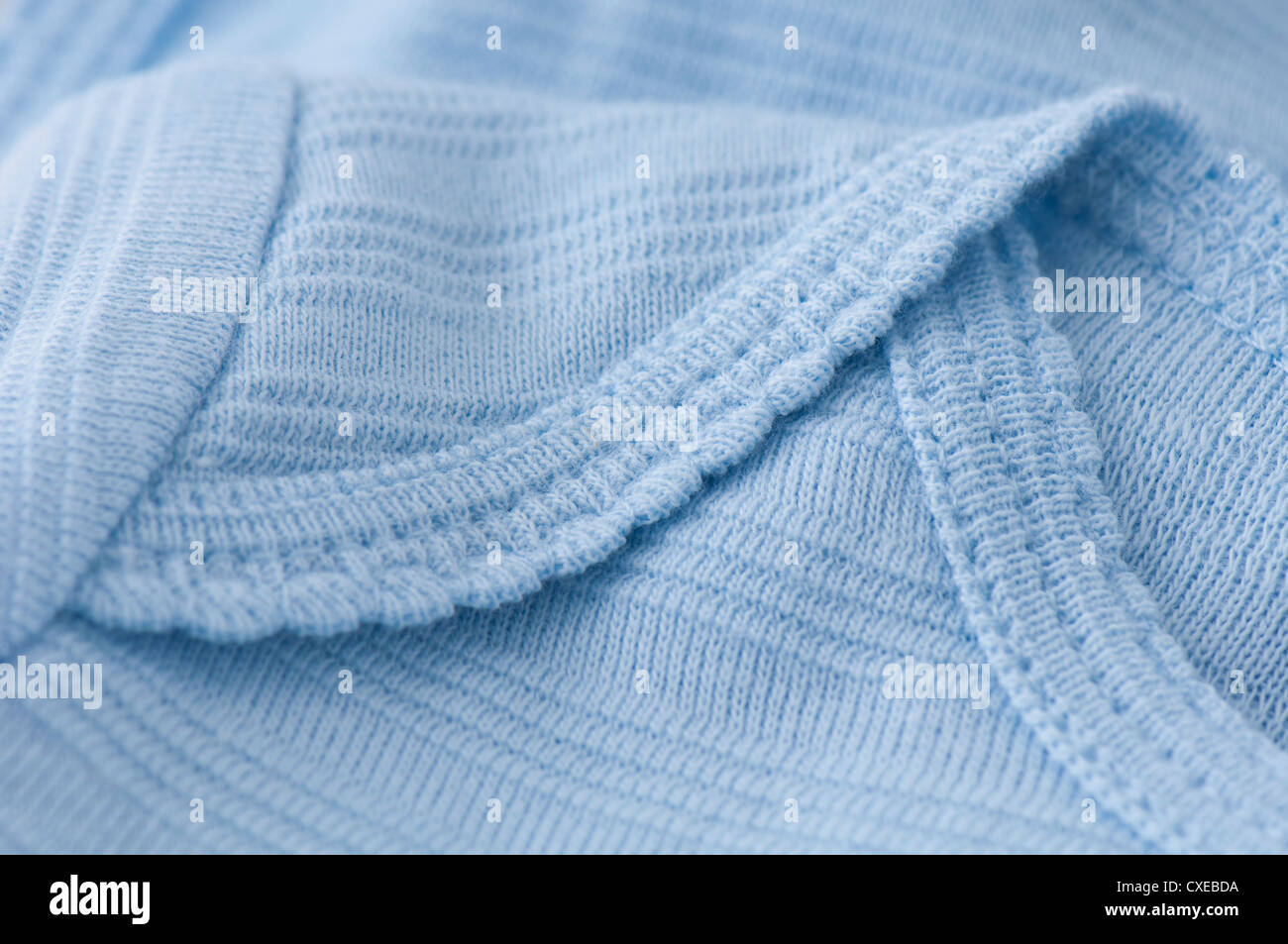 Knitted baby clothing, close-up - Stock Image