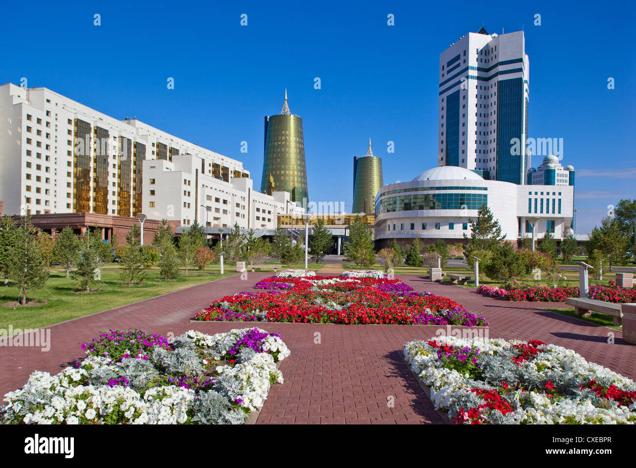 House of Ministries and twin golden conical business centres, Astana, Kazakhstan - Stock Image