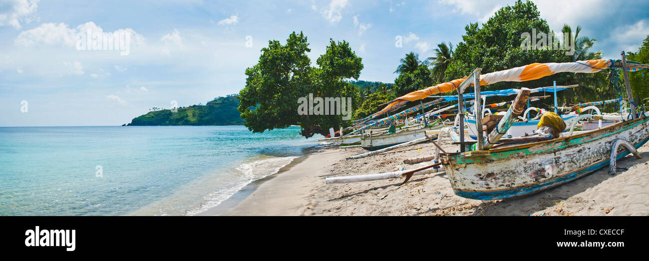 Traditional fishing boat at Nippah Beach on Lombok, a tropical island in West Nusa Tenggara, Indonesia, Southeast - Stock Image