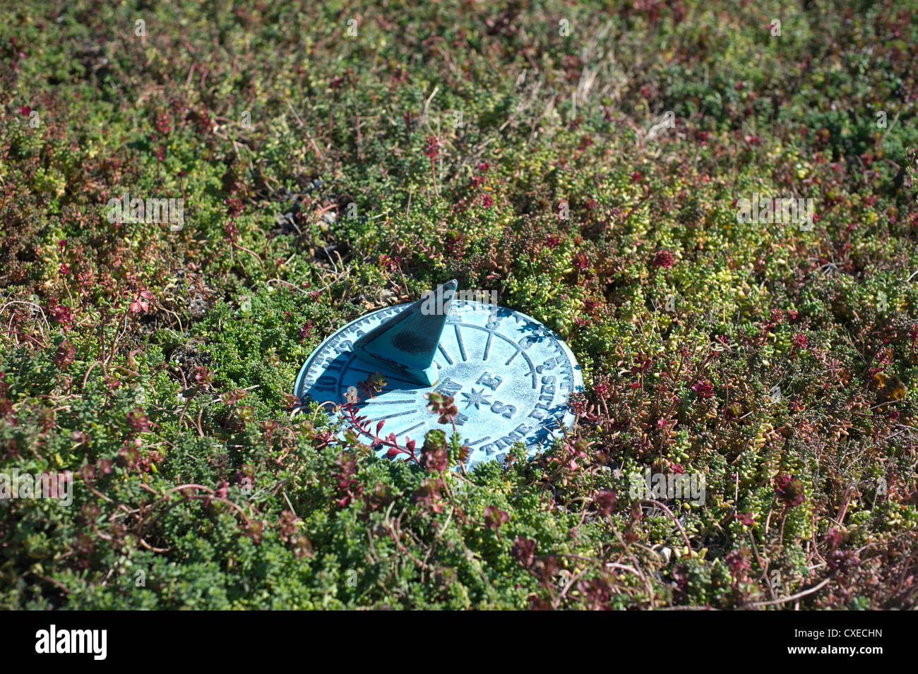 Sundial on a green roof in the Greenwich Village neighborhood in New York - Stock Image