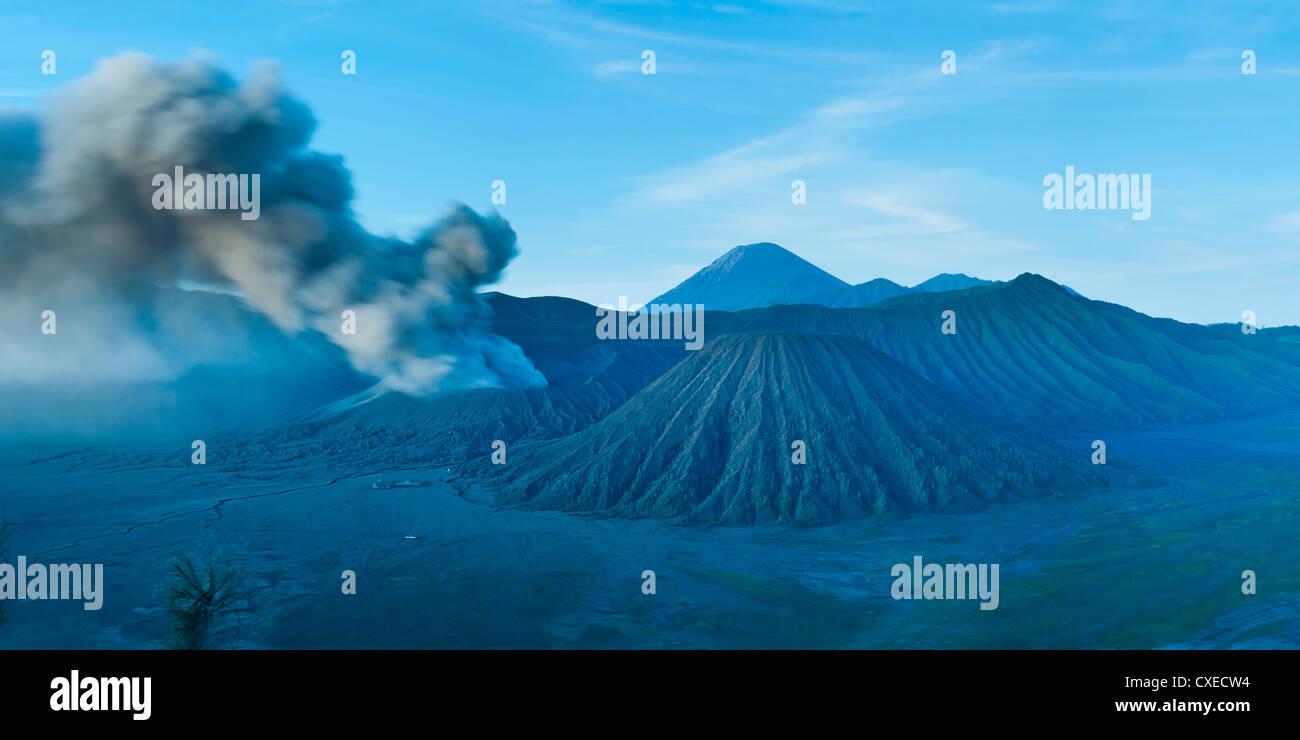 Mount Bromo volcano erupting before sunrise, East Java, Indonesia, Southeast Asia, Asia - Stock Image