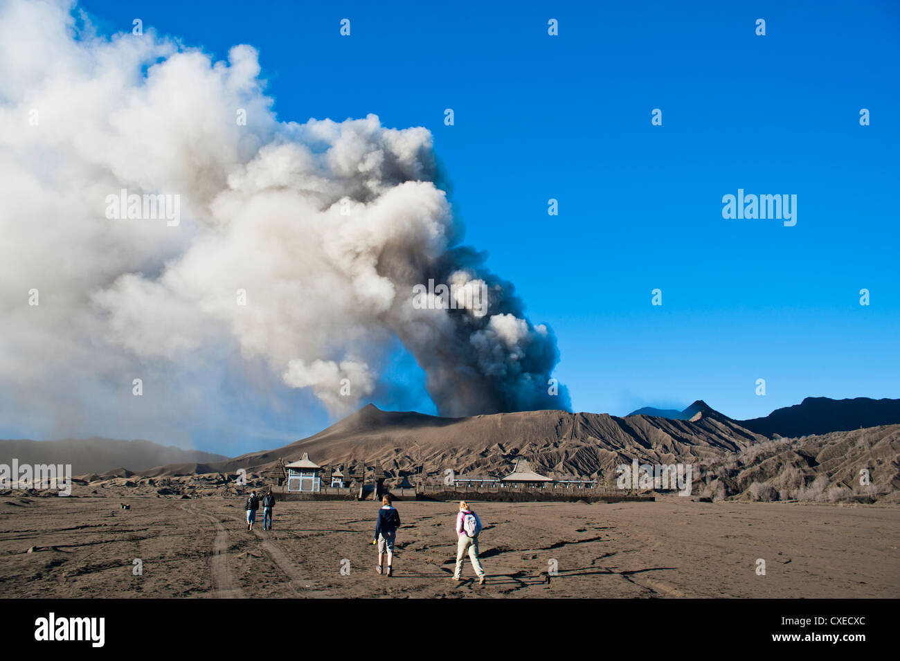 Tourists watching Mount Bromo volcanic eruption, East Java, Indonesia, Southeast Asia, Asia - Stock Image