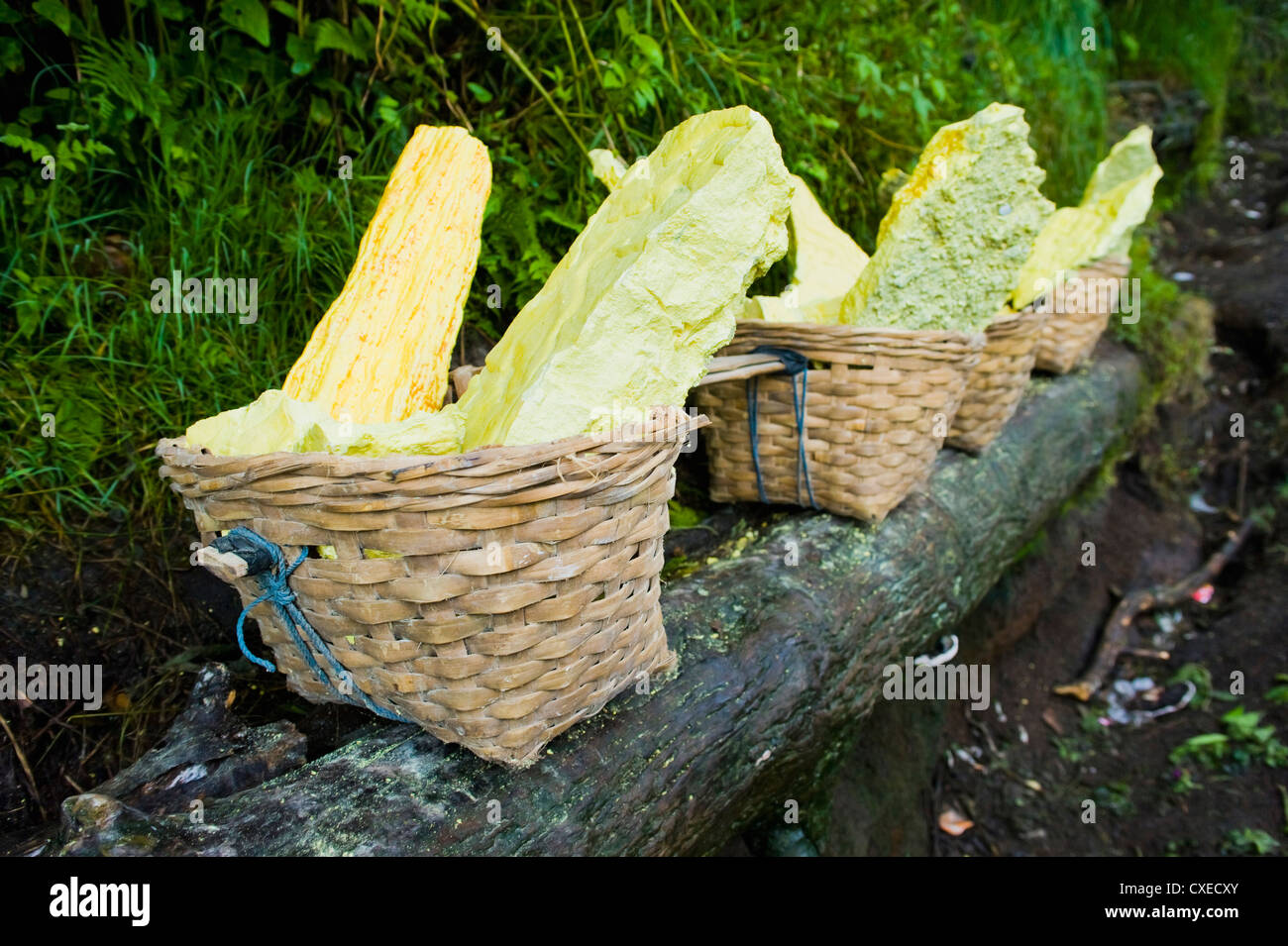 Baskets of bright yellow sulphur, Kawah Ijen, Java, Indonesia, Southeast Asia, Asia - Stock Image
