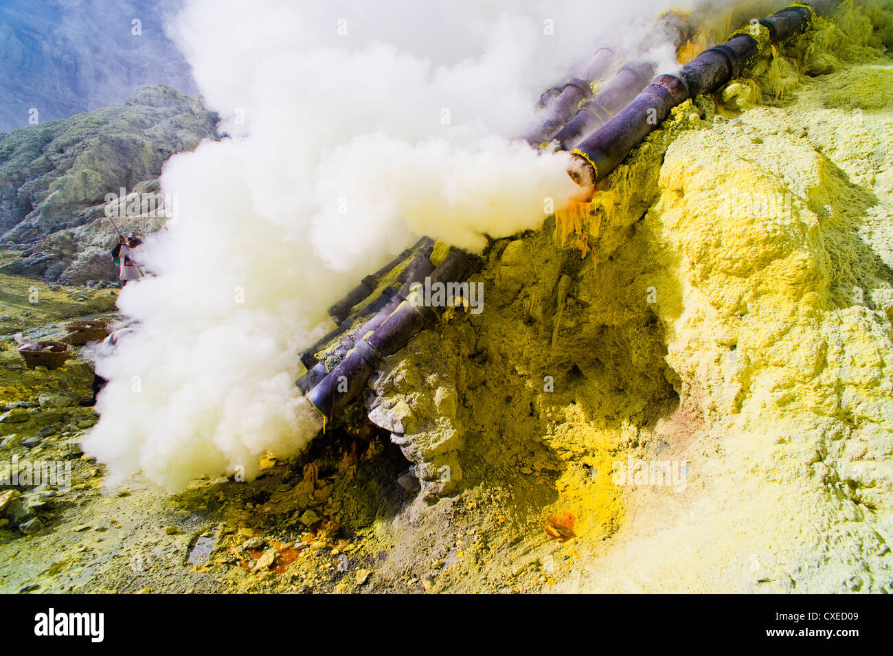 Toxic sulphur fumes escaping from the ceramic pipes at Kawah Ijen, Java, Indonesia, Southeast Asia, Asia - Stock Image