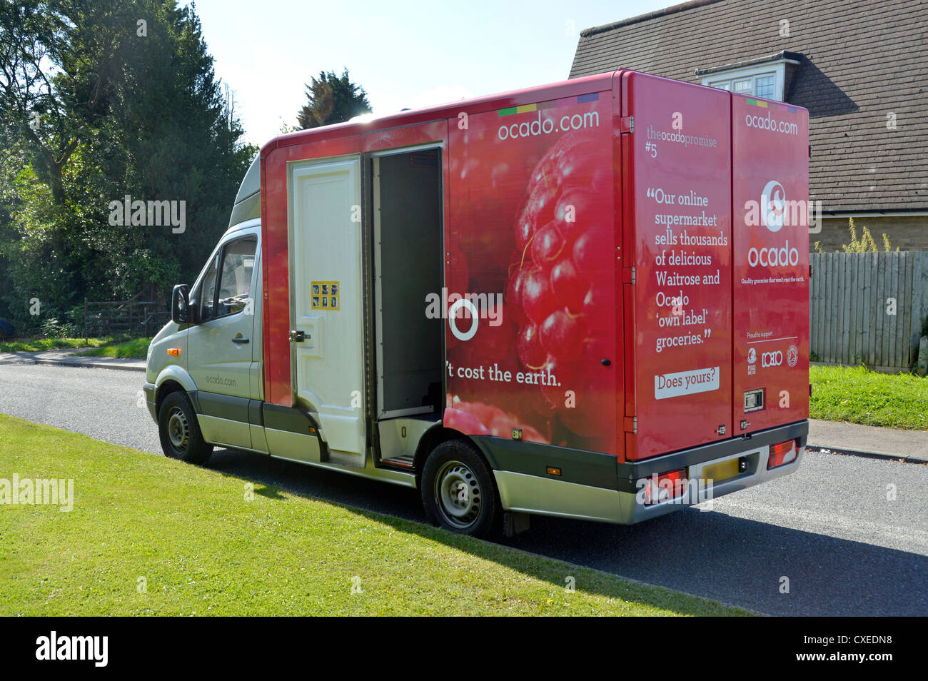 92e4e831c887e7 Ocado groceries home delivery van parked in residential turning whilst  driver makes deliveries to nearby home Brentwood Essex England UK