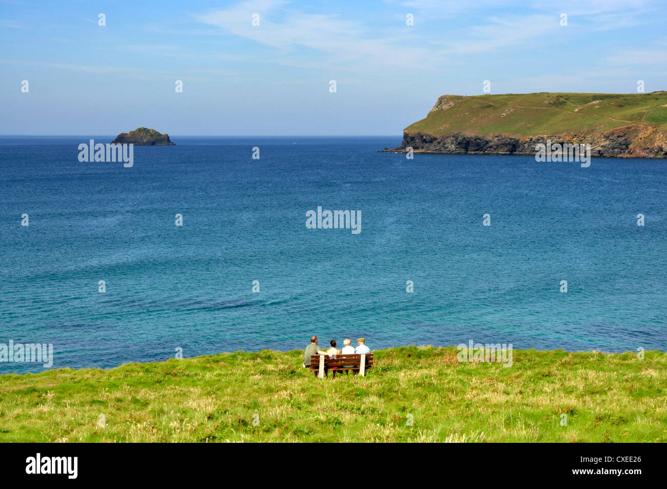 North Cornwall Coast Path - viewpoint to Pentire Point - across Hayle Bay - walkers resting on a bench - Stock Image