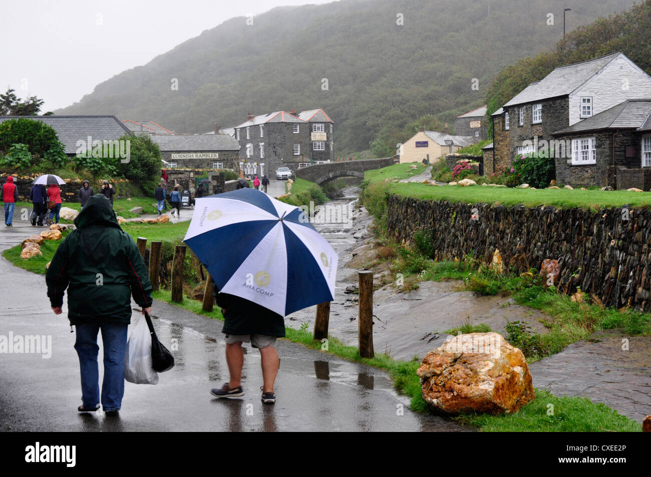 North Cornwall - Boscastle village - a wet day in September - tourists making the best of the weather - walking - Stock Image