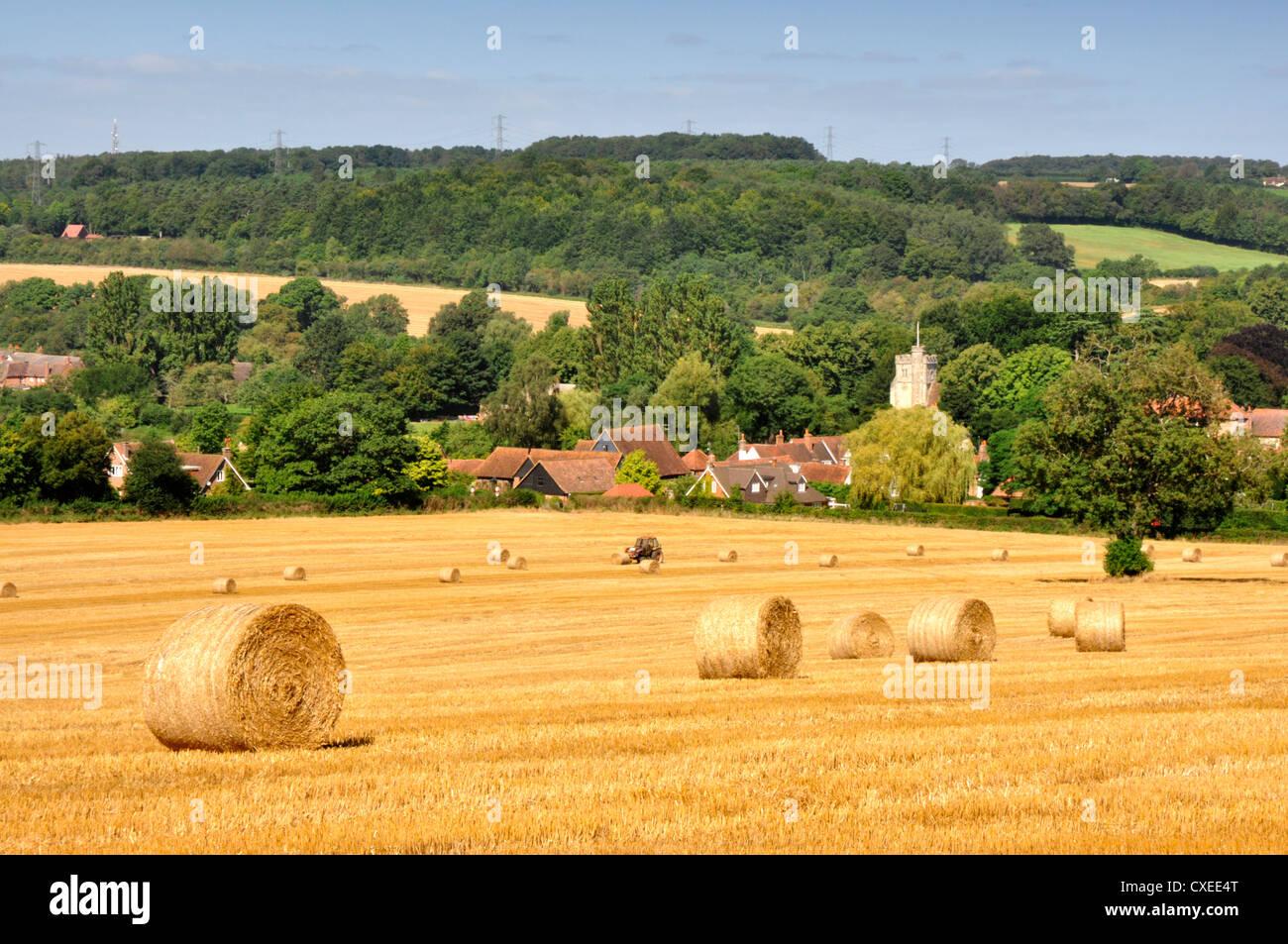 Chiltern Hills Buckinghamshire - harvested field - golden stubble and straw bales -autumn sunlight - backdrop Little - Stock Image