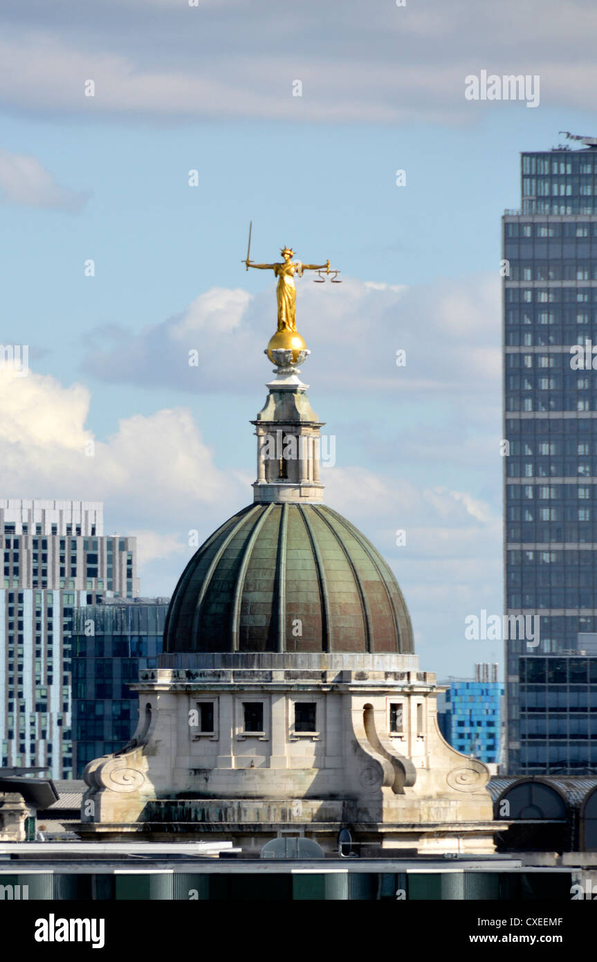 London skyline Lady Justice statue or Scales of Justice at the top of the Old Bailey building at the Central Criminal - Stock Image