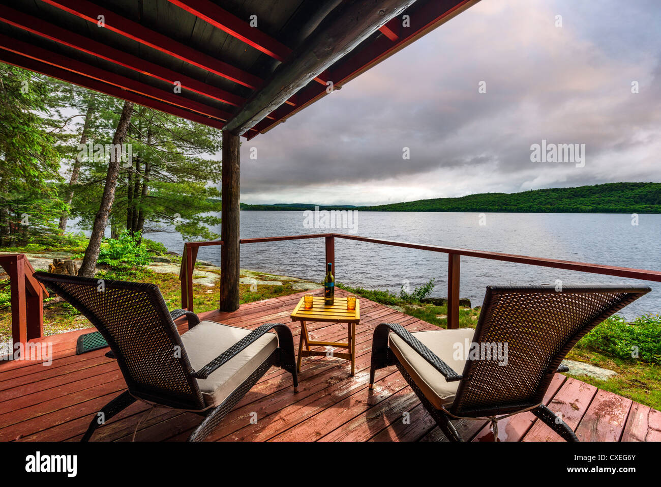Deck of lakefront cabin at the Killarney Lodge resort, Lake of Two Rivers, Algonquin Park, Ontario, Canada - Stock Image