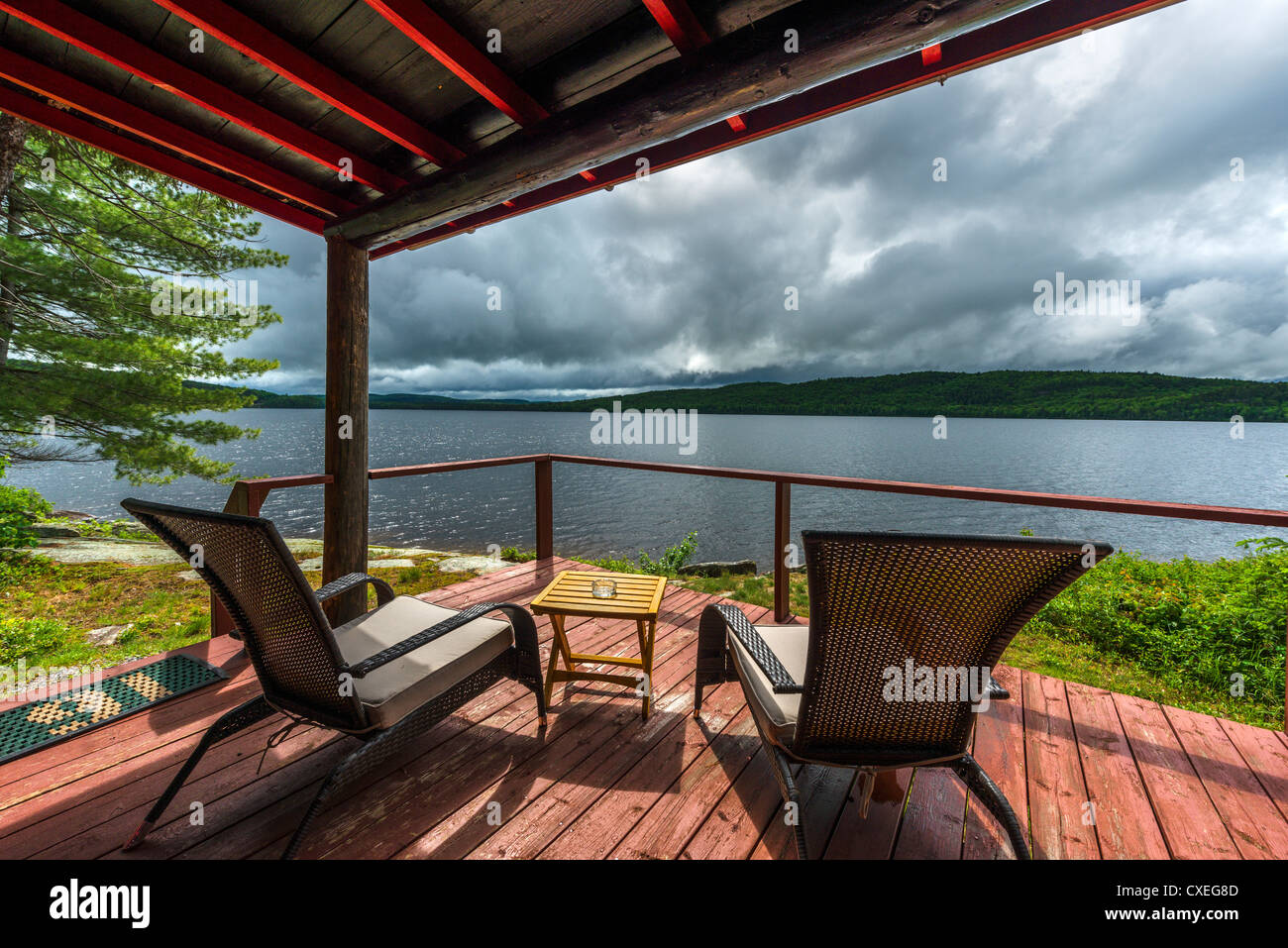 Deck of lakefront cabin at the Killarney Lodge resort just before a storm, Lake of Two Rivers, Algonquin Park, Ontario, - Stock Image