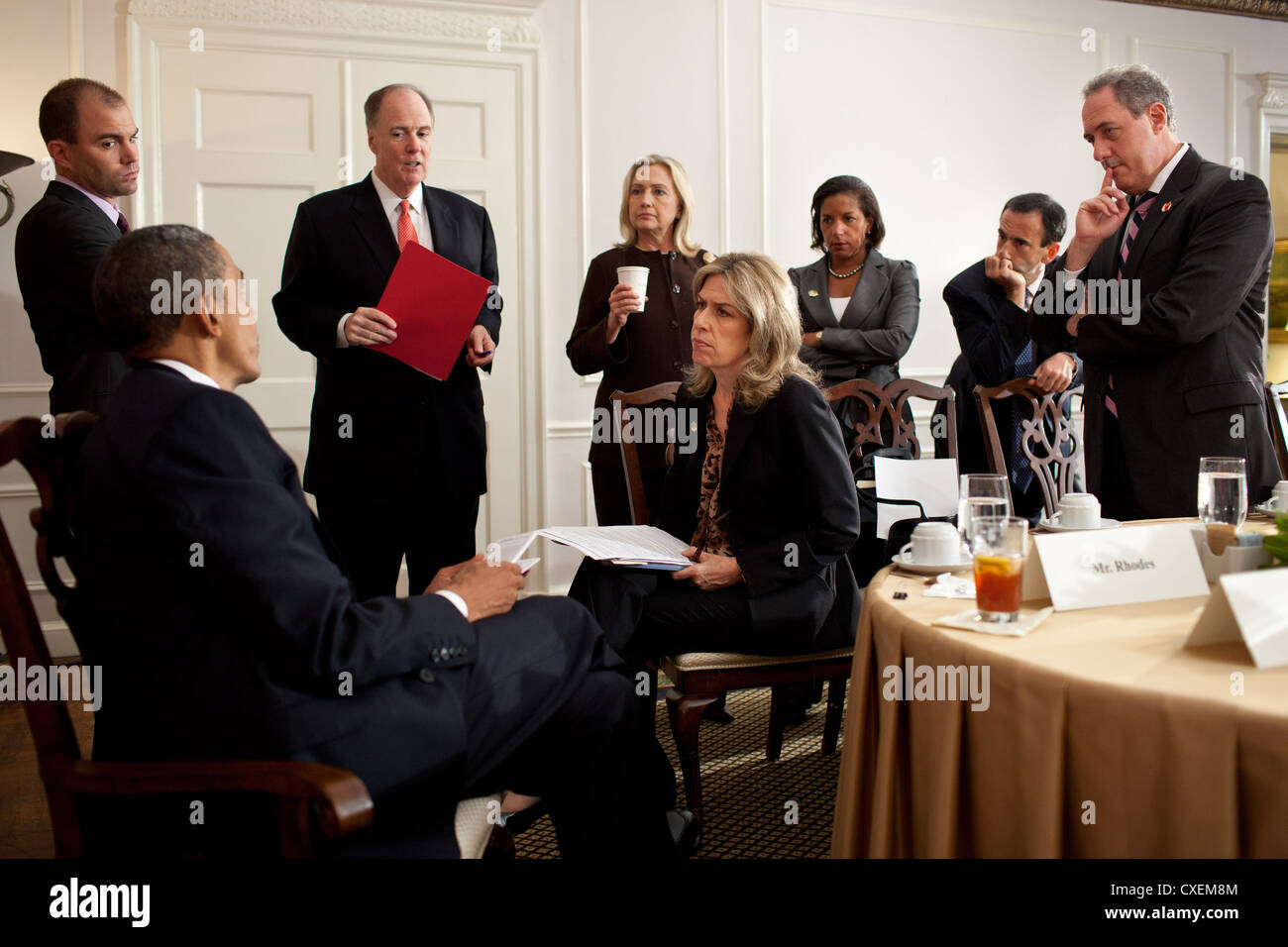 US President Barack Obama receives a briefing before a bilateral meeting with Prime Minister David Cameron of the - Stock Image